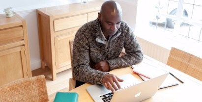 Arden University student studying at home