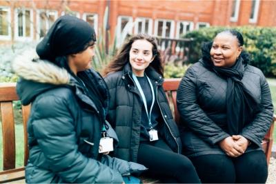 Arden University students sitting in study centre garden