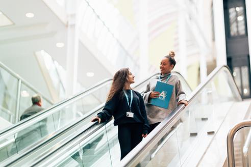 Arden University students on escalator at London study centre