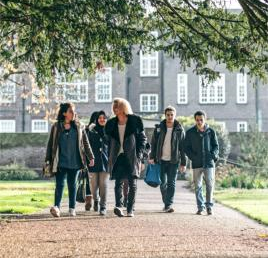 Arden University students walking at Mancheater study centre