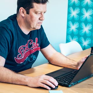 Man studying on a laptop
