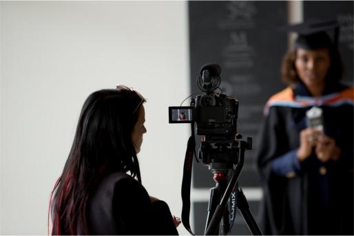 Arden University graduate having official graduation photos taken